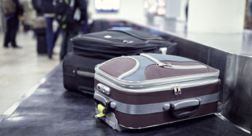 small suitcase on security conveyor belt