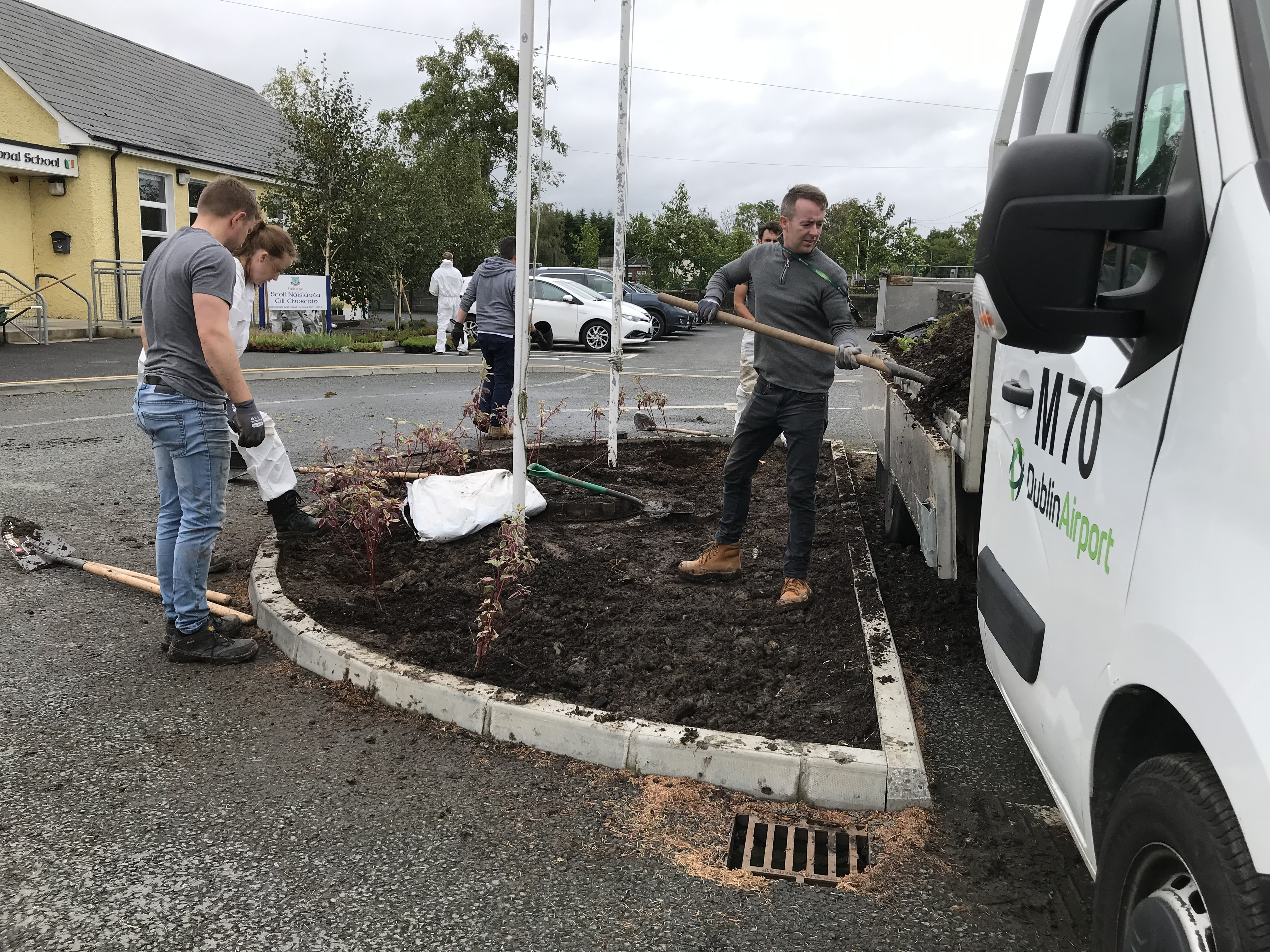 Dublin Airport's AMD carry out gardening works in a local school