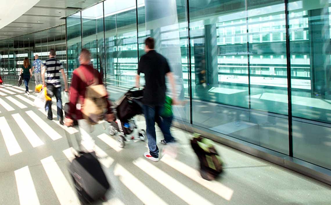 passengers walking on Dublin airport sky bridge