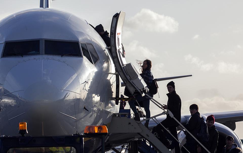 passengers boarding plane